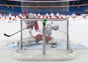 BUFFALO, NEW YORK - DECEMBER 26: Belarus goalie Andrei Grischenko #20 warms-up prior to a game against Switzerland during the preliminary round of the 2018 IIHF World Junior Championship. (Photo by Andrea Cardin/HHOF-IIHF Images)