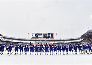 BUFFALO, NEW YORK - DECEMBER 29: USA players salute the crowd at New Era Field after the national anthem prior to preliminary round action against Canada at the 2018 IIHF World Junior Championship. (Photo by Matt Zambonin/HHOF-IIHF Images)