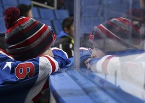 BUFFALO, NEW YORK - DECEMBER 31: A young fan looks on through the glass during Russia vs Sweden preliminary round action at the 2018 IIHF World Junior Championship. (Photo by Matt Zambonin/HHOF-IIHF Images)