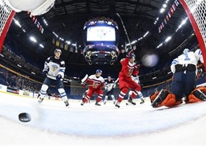 BUFFALO, NEW YORK - JANUARY 2: The Czech Republic's Filip Zadina #18 (not shown) scores a first period goal against Finland's Ukko-Pekka Luukonen #1 while Olli Juolevi #7 looks on and Martin Kaut #16 celebrates during quarterfinal round action at the 2018 IIHF World Junior Championship. (Photo by Matt Zambonin/HHOF-IIHF Images)