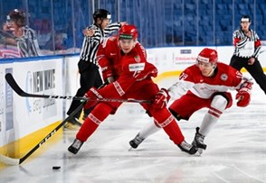 BUFFALO, NEW YORK - JANUARY 4: Belarus forward Yegor Sharangovich #17 carries the puck up ice ahead of Denmark's Jonas Rondbjerg #16 during the relegation round of the 2018 IIHF World Junior Championship. (Photo by Andrea Cardin/HHOF-IIHF Images)