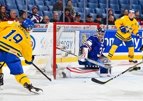 BUFFALO, NEW YORK - JANUARY 4: Sweden's Alexander Nylander #19 fires a shot at USA's Joseph Woll #31 during the semi-final round of the 2018 IIHF World Junior Championship. (Photo by Andrea Cardin/HHOF-IIHF Images)