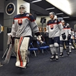 BUFFALO, NEW YORK - DECEMBER 27: Slovakia's David Hrenak #1 and Adam Ruzicka #21 lead their team to the ice for warm-up prior to preliminary round action against Canada at the 2018 IIHF World Junior Championship. (Photo by Matt Zambonin/HHOF-IIHF Images)