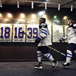 BUFFALO, NEW YORK - DECEMBER 28: Finland's Urho Vaakanainen #23 and Henri Jokiharju #28 walk to the ice surface for preliminary round action against Denmark at the 2018 IIHF World Junior Championship. (Photo by Matt Zambonin/HHOF-IIHF Images)